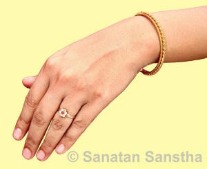 Why do women wear ring in the left hand and men in their right hand