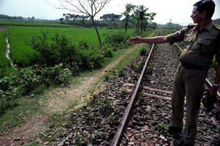 Member of India's BSF points out a well-traveled path along the India-Bangladesh border