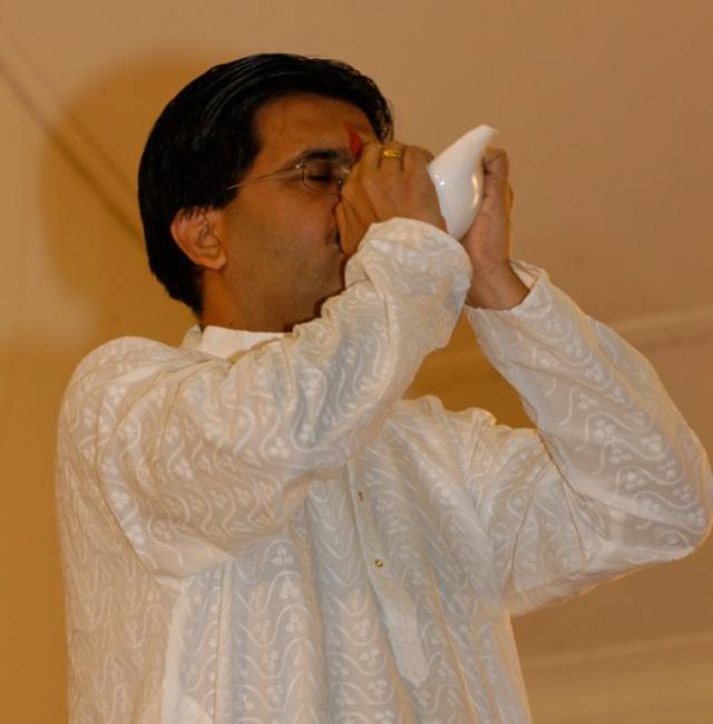 Mr. Atul Dighe blowing a Conch