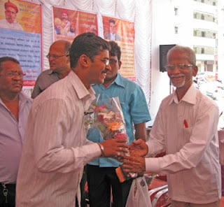 Mr. Mahadev Devale while felicitating Mr. Sagvekar from HJS