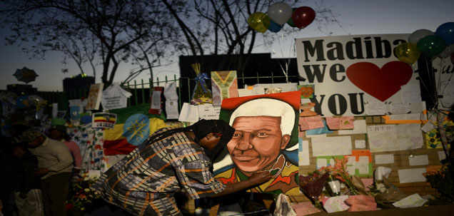 A man paints a portrait of ailing Nelson Mandela