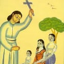 A pastor in saffron robes tells pilgrims about Jesus at Haridwar