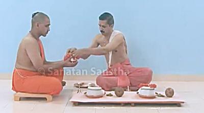 Offering udak-kumbh to Brahmans