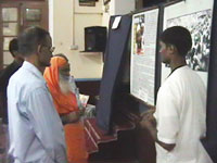 How does the Hindu Janajagruti Samiti (HJS) organize exhibitions?