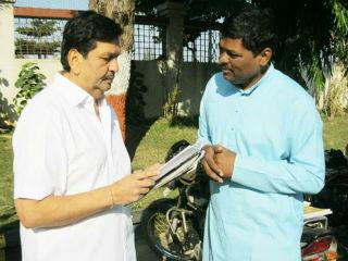 Shri. Sunil Ghanavat (on right) explaining NCERT issue to MLA Mangalprabhat Lodha