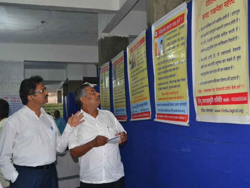 Exhibition being explored by dharmabhimani advocate Shri.Geete & Shri. Jadhav