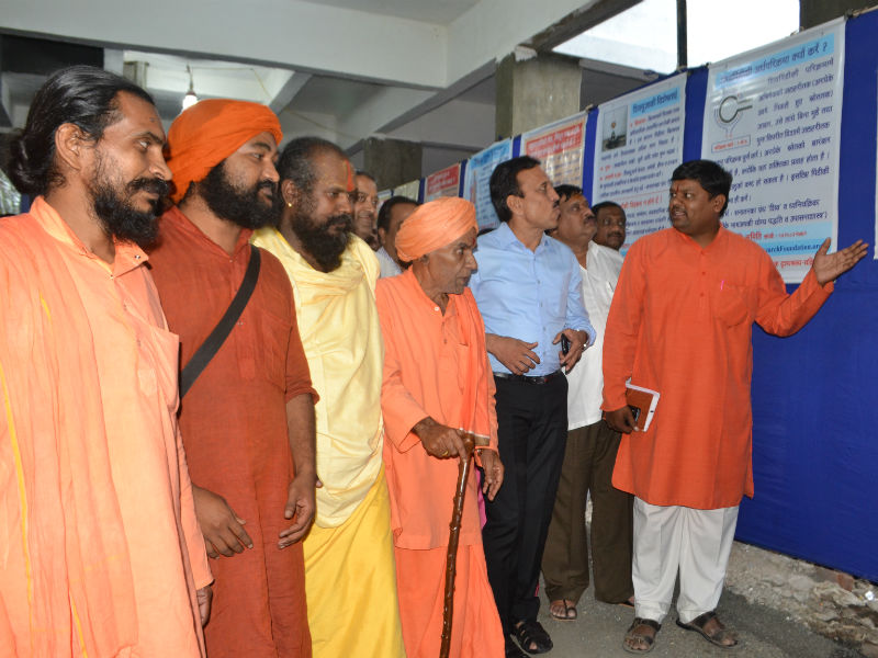 Exhibition being studied by the dignitaries
