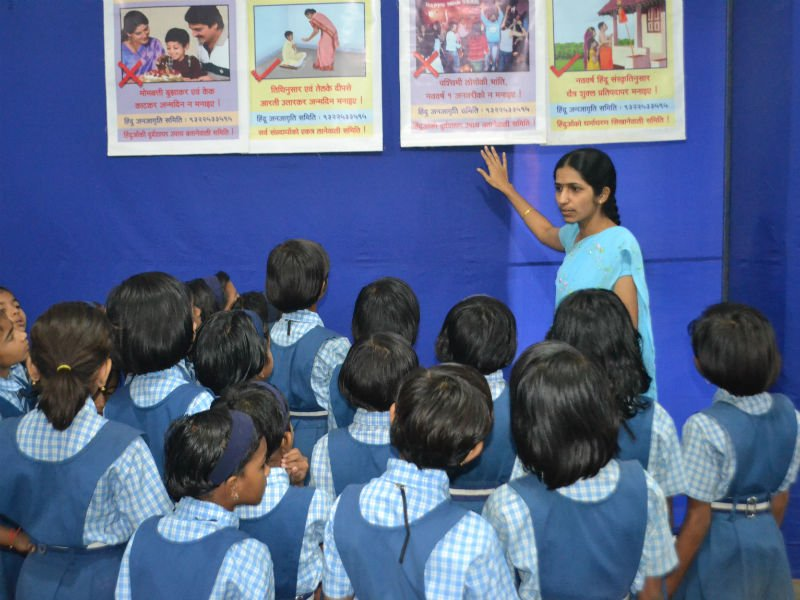 Sanatan's seeker explaining the charts to the students