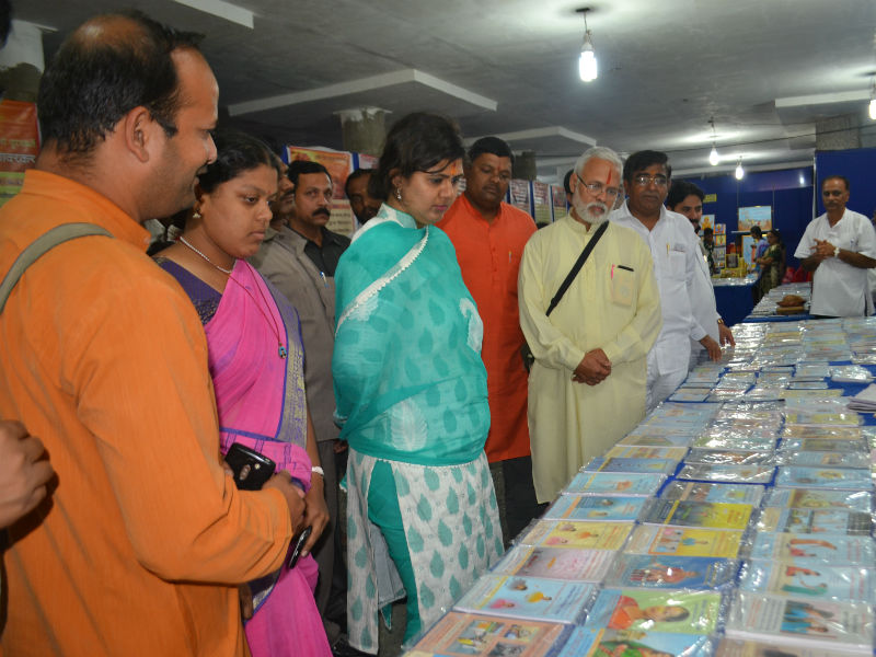 Minister Pankaja Munde-Palave  having a look at the Sanatan's Holy Texts