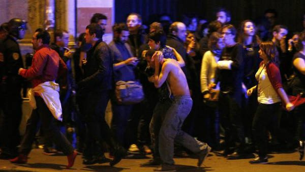Wounded people are evacuated outside the scene of a hostage situation at the Bataclan theatre in Paris. P icture: EPA/YOAN VALAT (Source:News Corp Australia)