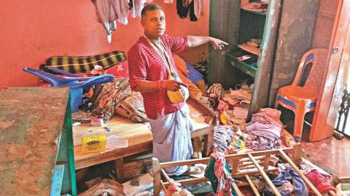 A Hindu priest shows a vandalised room of a priest at Goura Temple in Brahmanbaria's Nasirnagar upazila. (Daily Star file photo)