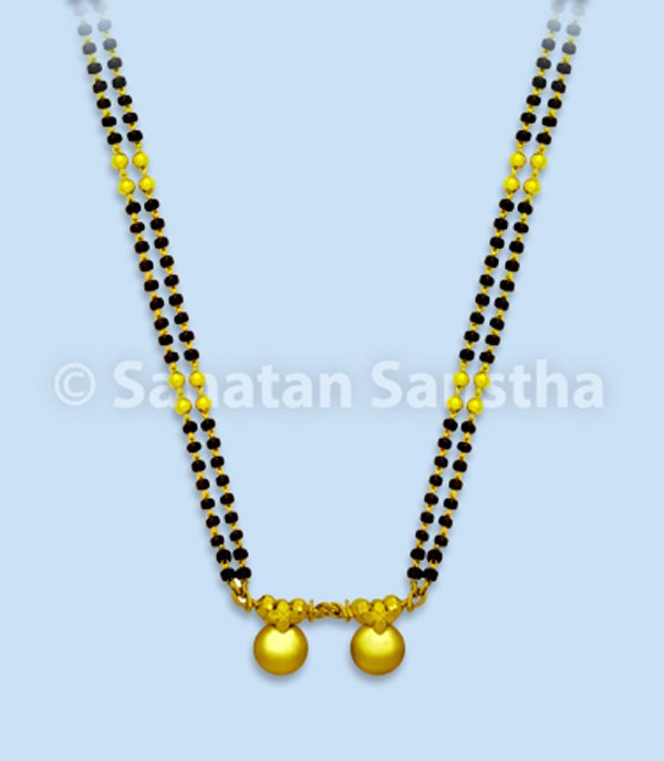 What do the two strings of black beads in the mangalsutra